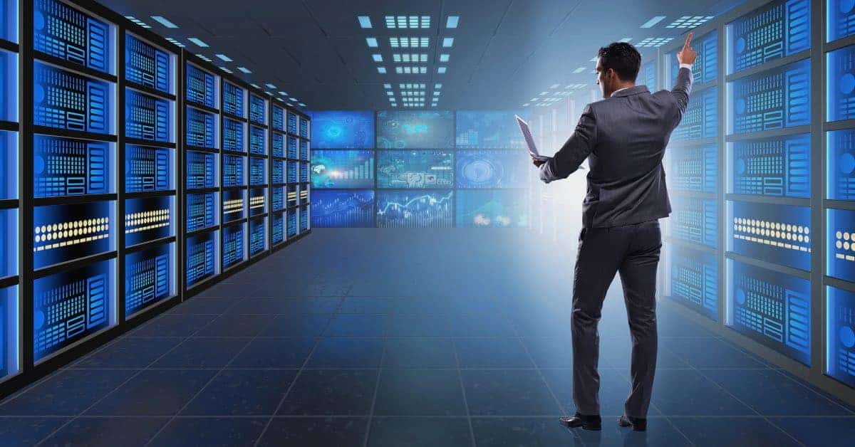 man standing in a room with bare metal backup and restore servers