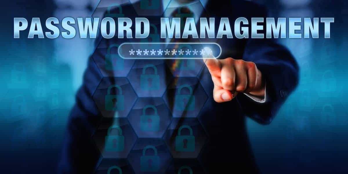 man with his hand on screen that says password management