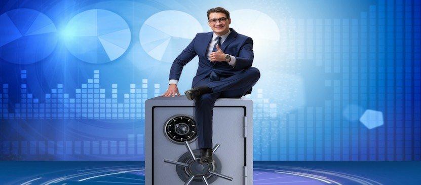 businessman sitting on a secure safe