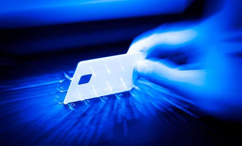 hand over a laptop to use a credit card online