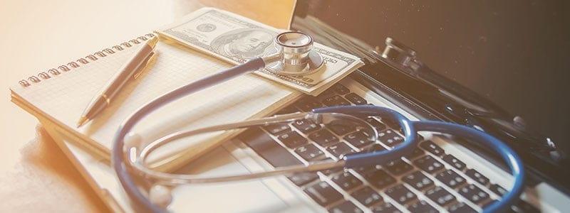 laptop on a healthcare professionals desk