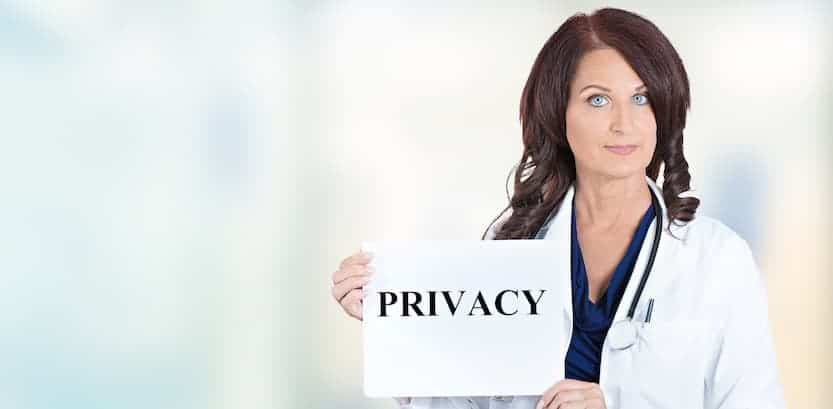 woman holding sign for HIPAA Privacy