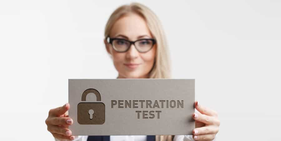 woman holding a sign that says penetration testing
