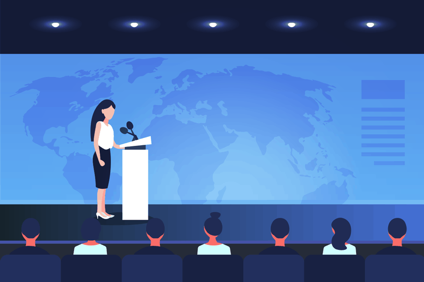woman giving a speech on stage at security conference