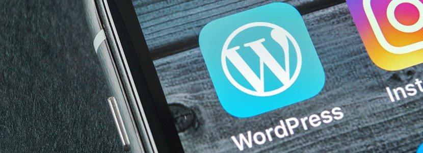 a mobile phone displaying the wordpress logo