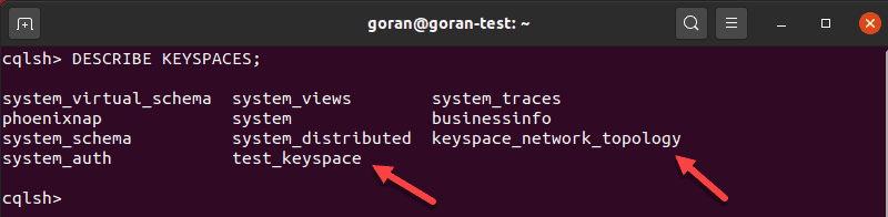 Terminal output showing available keyspaces in Cassandra.